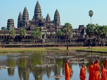 Buddhist Monks In Front Of The Angkor Wat 3 420x315