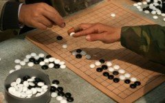 Playing_weiqi_in_Shanghai-300x200.jpg