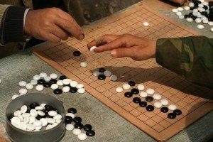 Google's artificial intelligence program defeats legendary Go player Lee Sedol
