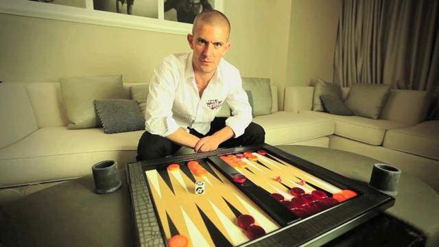 Gus playing Backgammon
