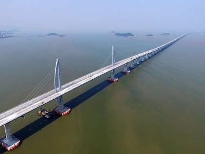 Macau Briefs: Longest sea bridge nears completion; Galaxy acquires Wynn shares; Macau revenue up in March