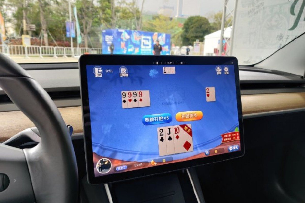 Tesla Adds Poker To In Car Arcade Games